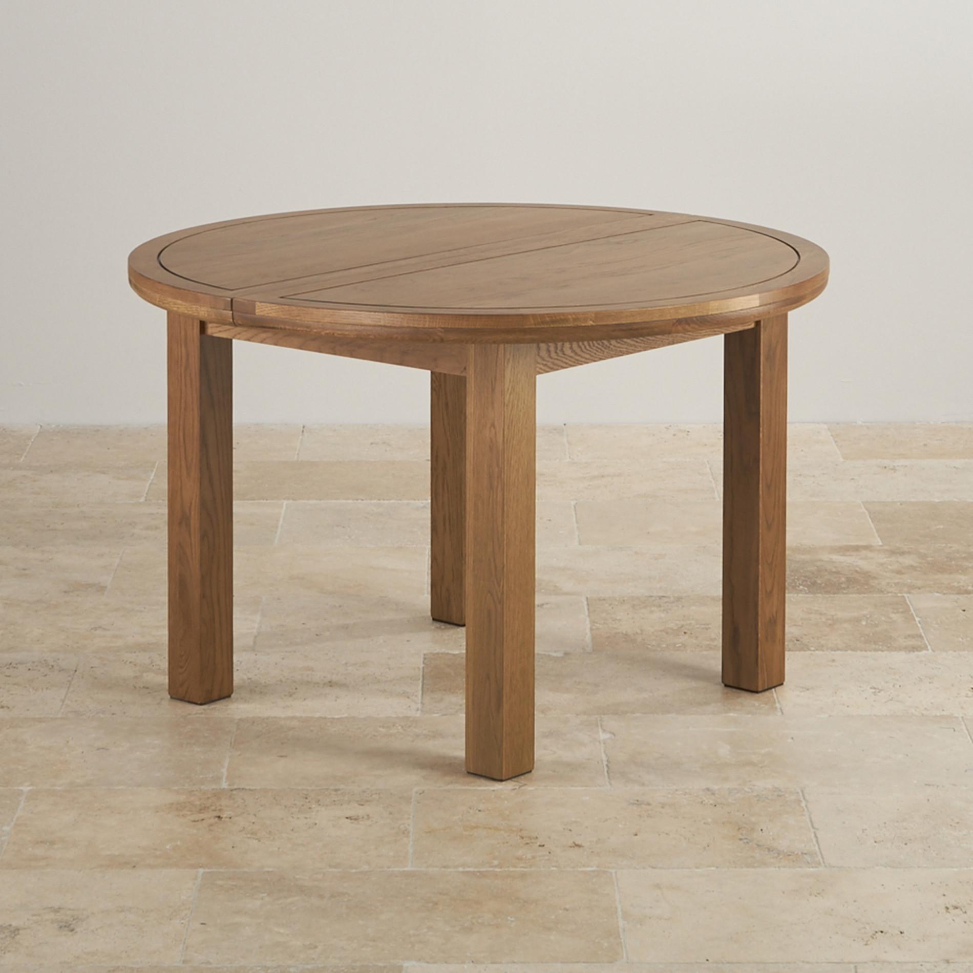 Round extending dining table in rustic oak oak furniture land - Round extending dining table ...
