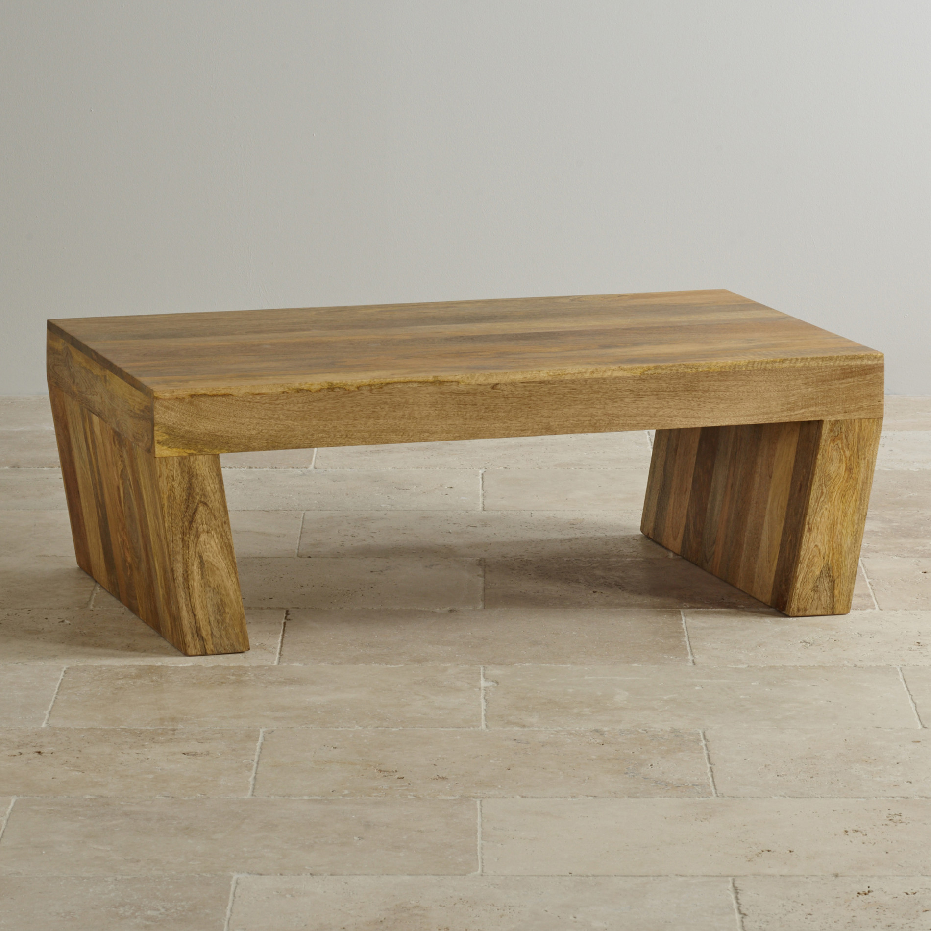 mantis light coffee table in solid mango  oak furniture land - custom delivery mantis light natural solid mango angled coffee table