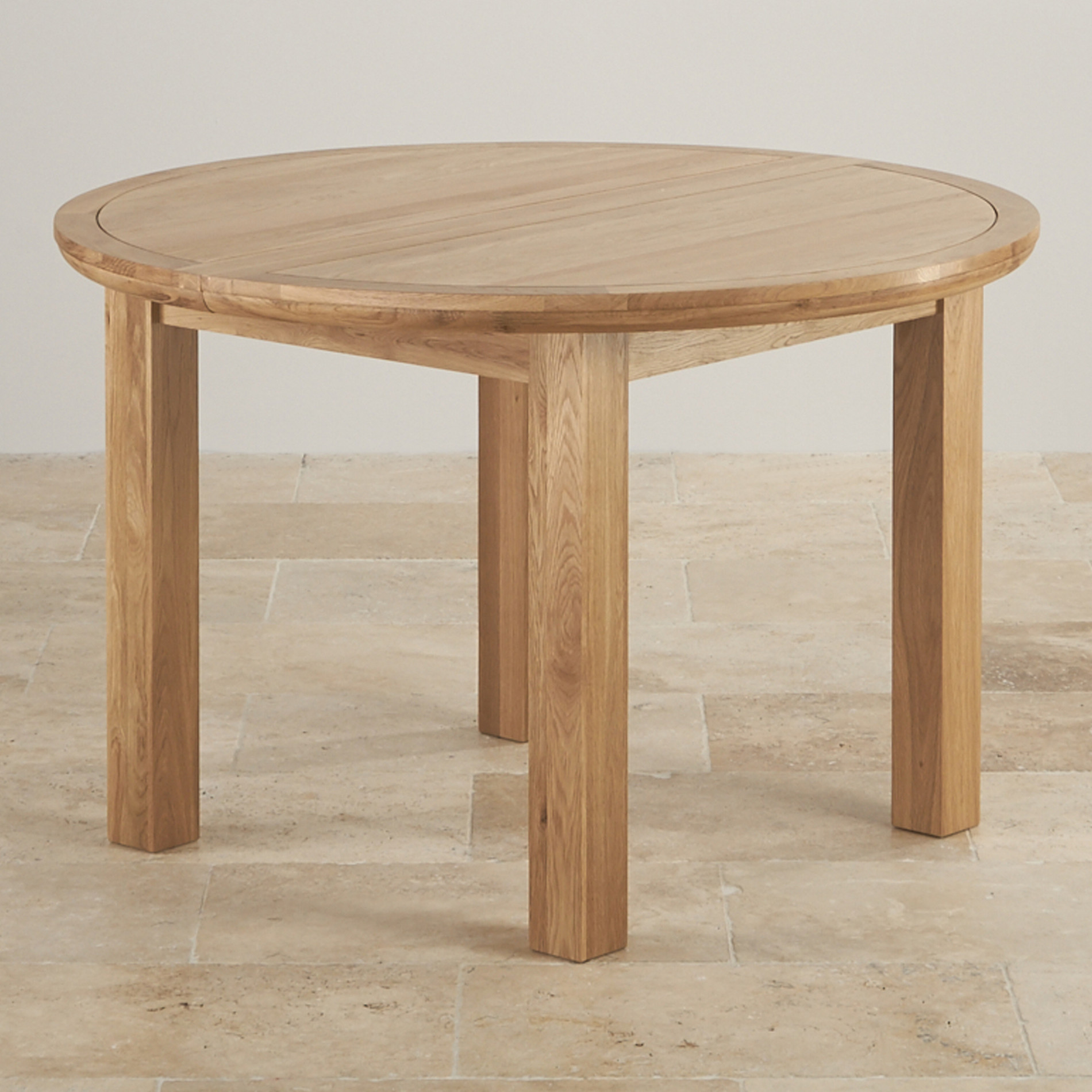 . knightsbridge ft extending round dining table in natural oak